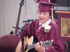 Graduation Student Playing Guitar