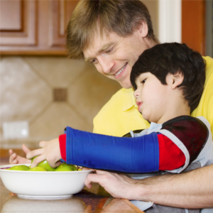 Older male with young child with fruit bowl